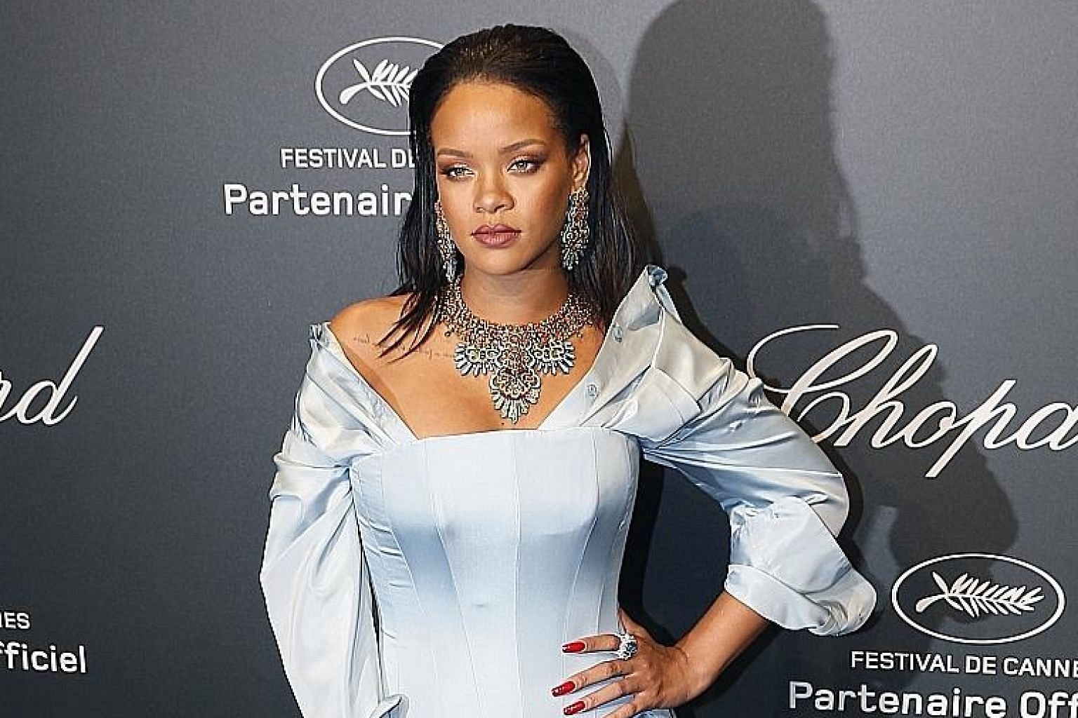 A package donated by Rihanna (left) for a benefit that included tickets to her fashion show was sold at US$24,000 (S$33,340).