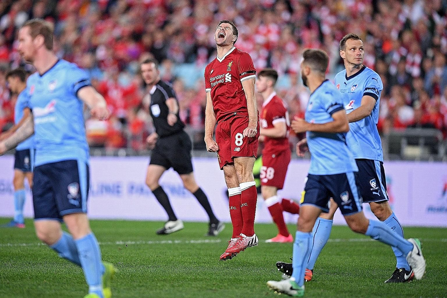 Liverpool great Steven Gerrard reacting after missing a shot at goal during the exhibition match against Sydney FC.