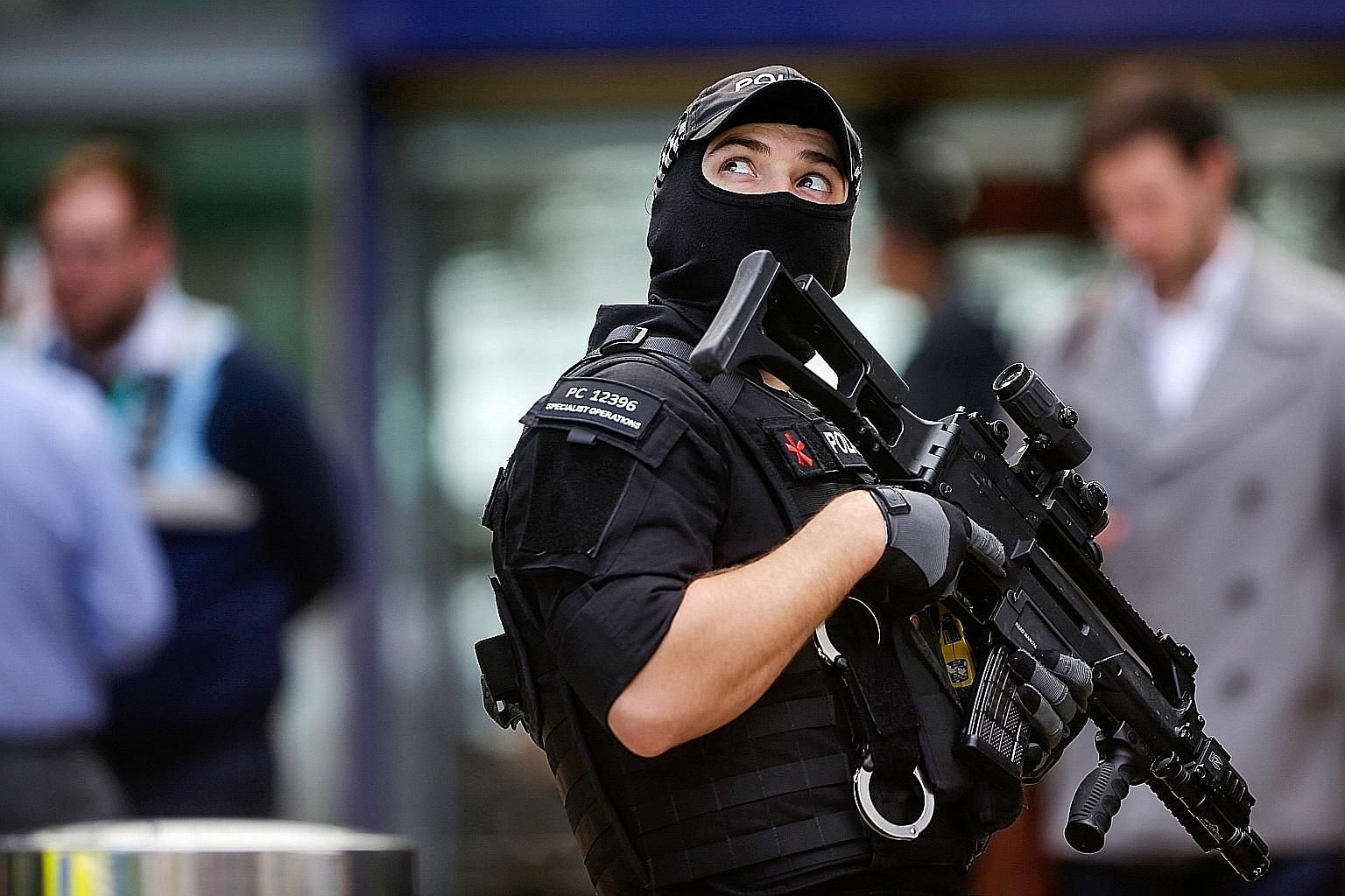 An armed officer patrolling Manchester Piccadilly railway station on Tuesday after a terror attack the night before at a pop concert left at least 22 dead.