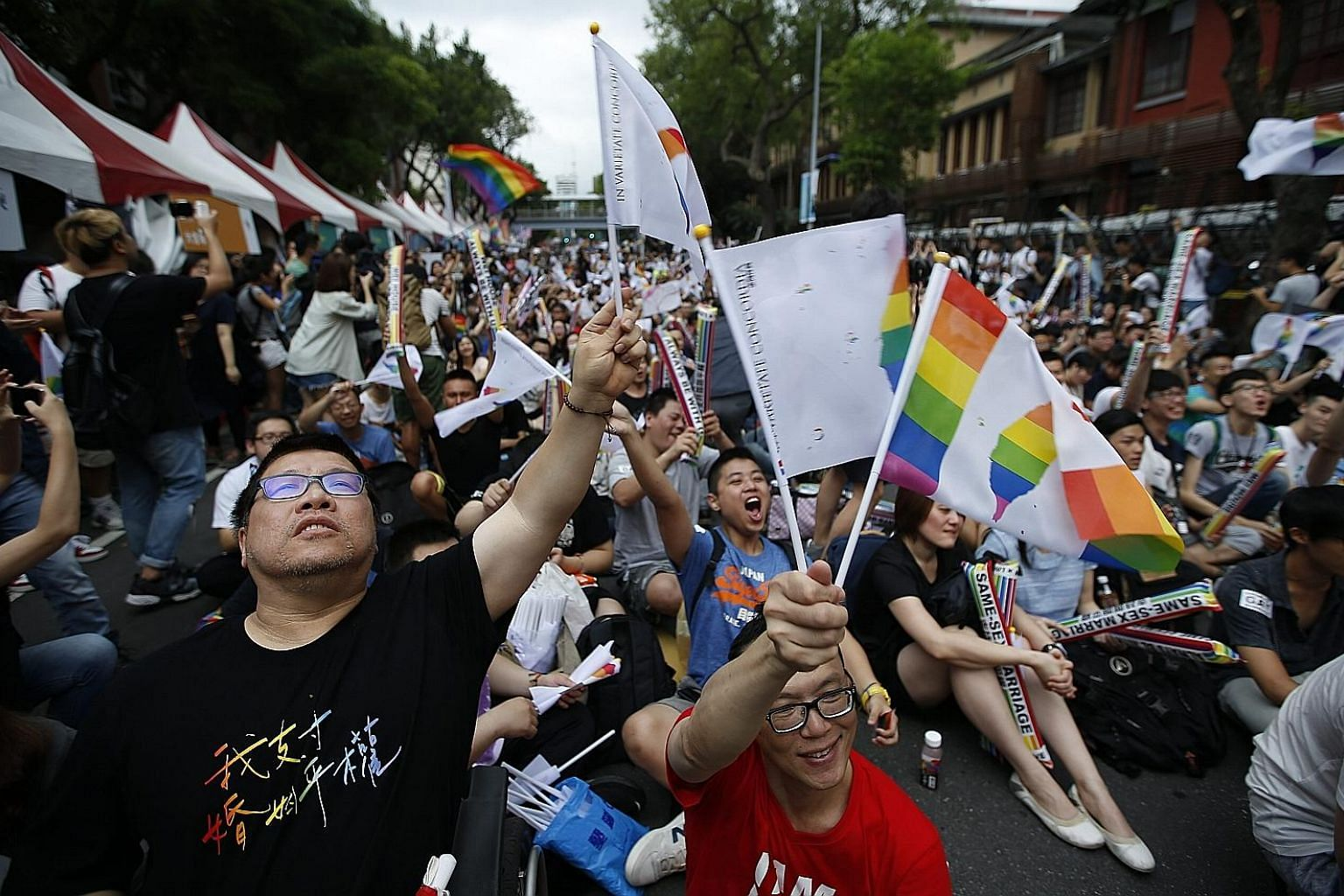 Supporters of same-sex marriage celebrating yesterday outside the Parliament building in Taipei. The Constitutional Court ruled that the island's civil law, which defines marriage as a union between a man and a woman, violates constitutional guarante