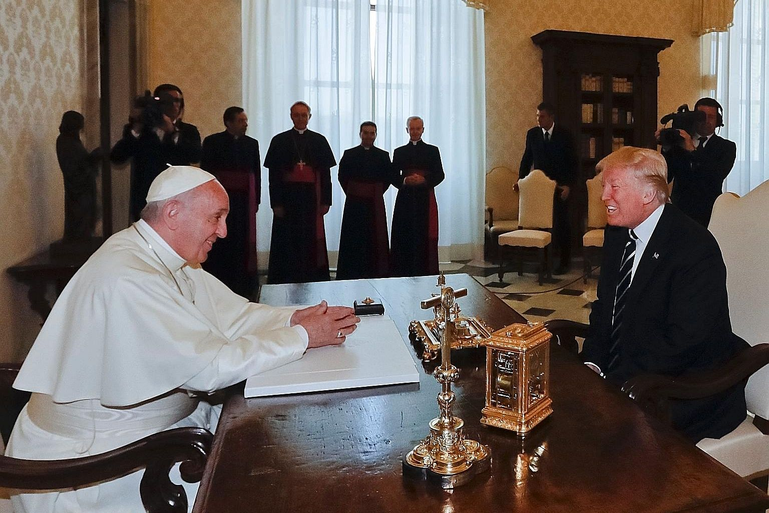 Pope Francis and US President Donald Trump at the Vatican yesterday. Their meeting, which lasted for less than half an hour, started on a subdued note but ended with both leaders beaming.
