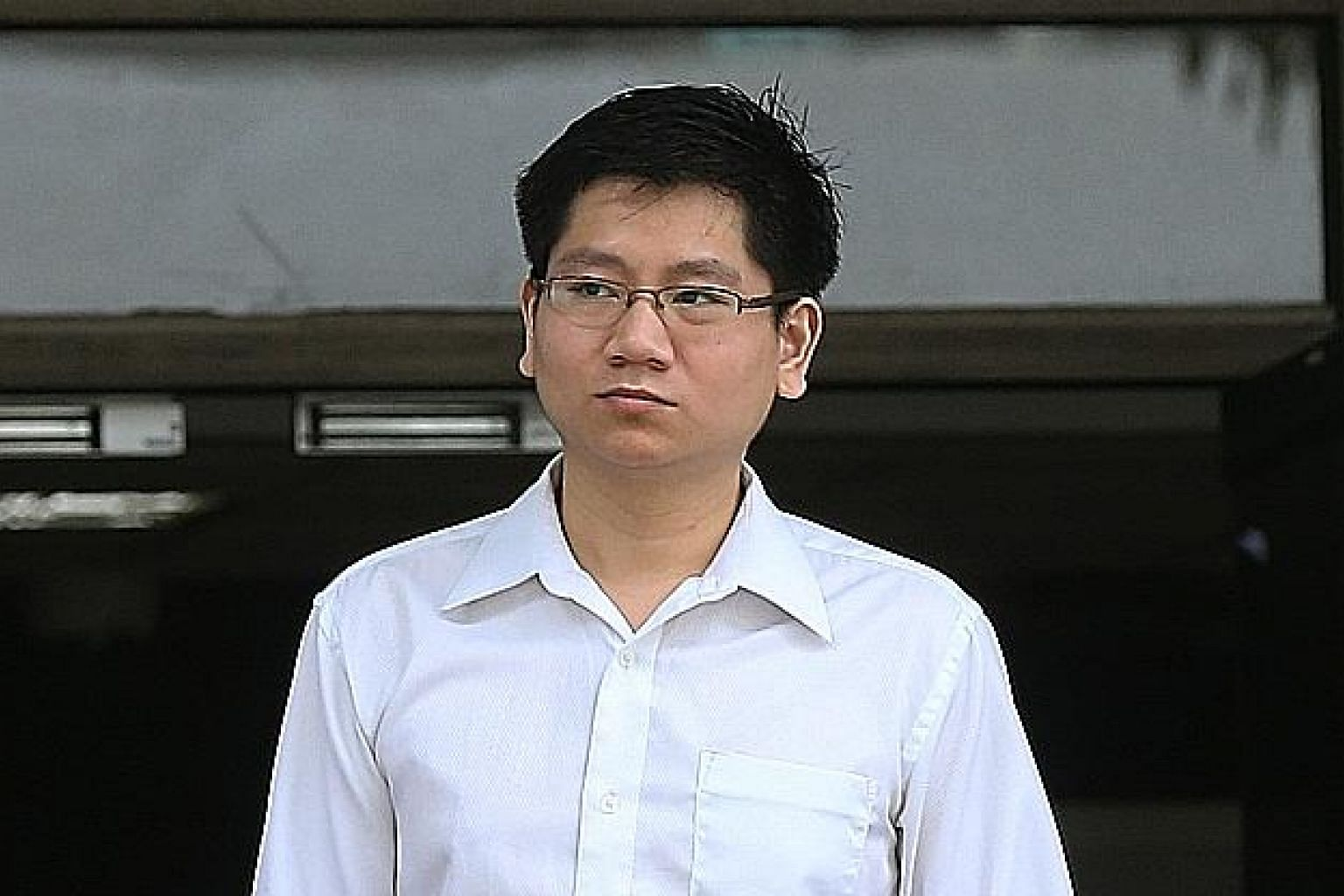 Wang Yong Jie leaving court yesterday. He admitted to committing mischief by scratching the right side of Mr Johnny Fang Hsiang Yoong's Suzuki Kizashi from the back to the front at the open-air carpark at The Grandstand mall in Turf Club Road on Marc