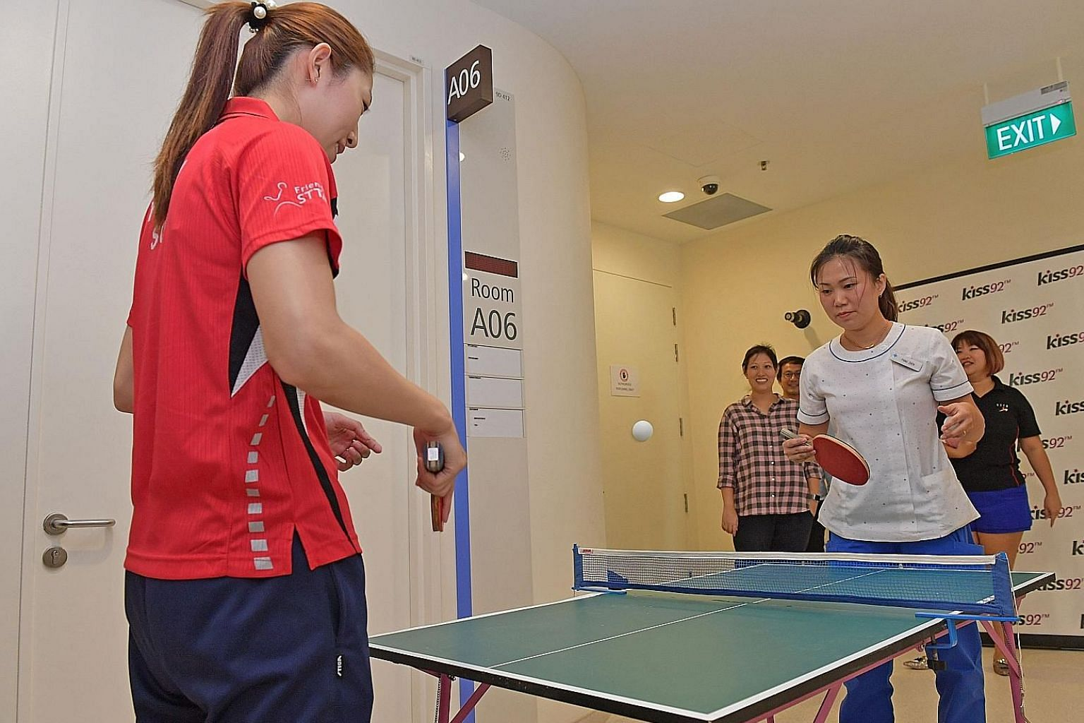 Yu Mengyu having fun sparring with a nurse at the National University Hospital's Children's Cancer Centre yesterday, as national paddlers continue their tradition of doing community work before they leave for the World Table Tennis Championships, hel