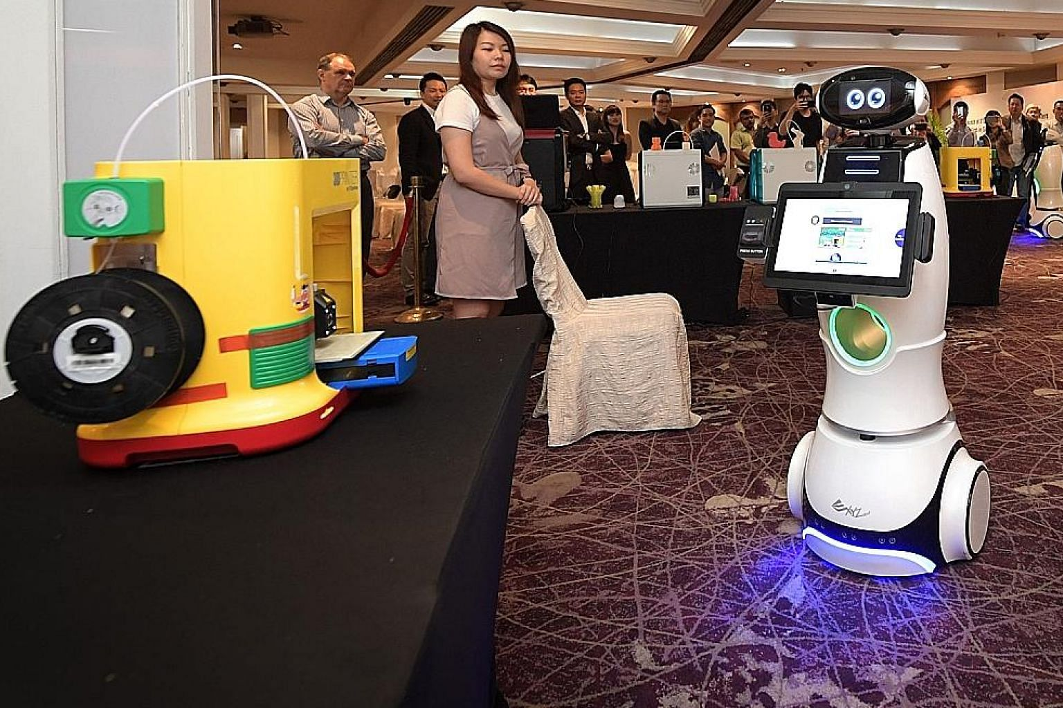 The XYZrobot showing visitors what it can do at Marina Mandarin Hotel yesterday. The retail robot was launched along with 3D desktop printers by Newstead Technologies.