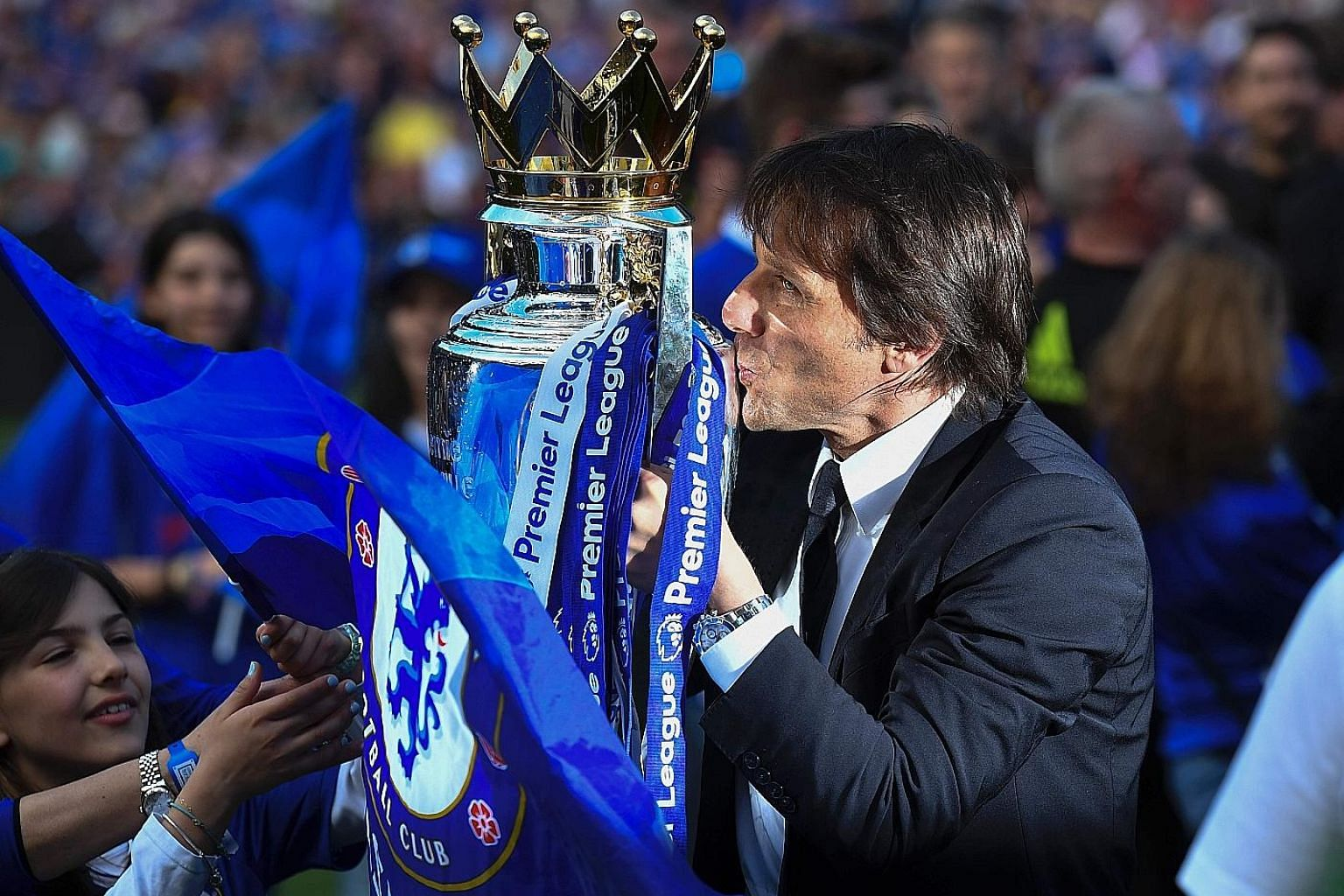 Antonio Conte celebrating capturing the Premier League trophy with Chelsea in his first season in charge. The Italian will attempt to complete a league and Cup double when his side take on Arsenal at Wembley.