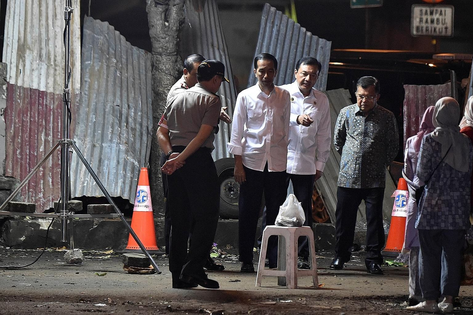 (From third from left) President Joko Widodo, State Intelligence Agency chief Budi Gunawan, and Indonesian Vice-President Jusuf Kalla at the bomb blast site at the Kampung Melayu bus station in Jakarta on Thursday.