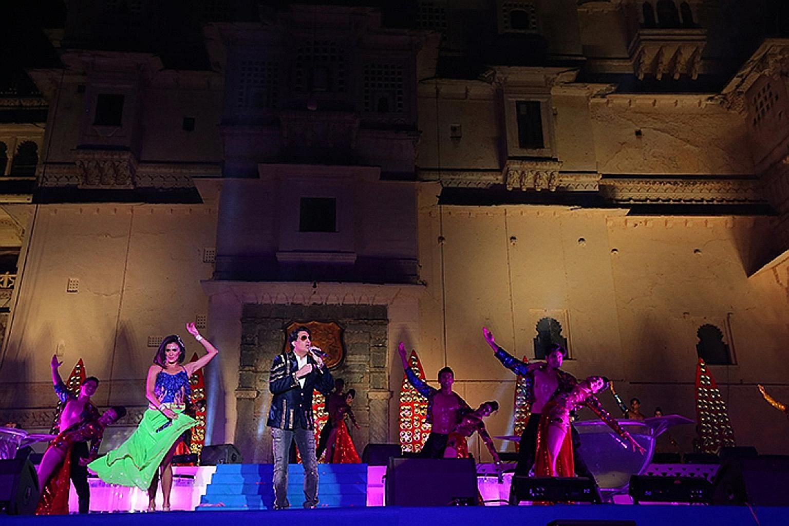 Indian celebrity Shiamak Davar (above) performing at Udaipur's City Palace during the wedding of businessman Binod Chaudhary's son, Varun, and his bride, Anushree (right). Around 2,000 guests were whisked to the Rajasthan lake city on chartered fligh