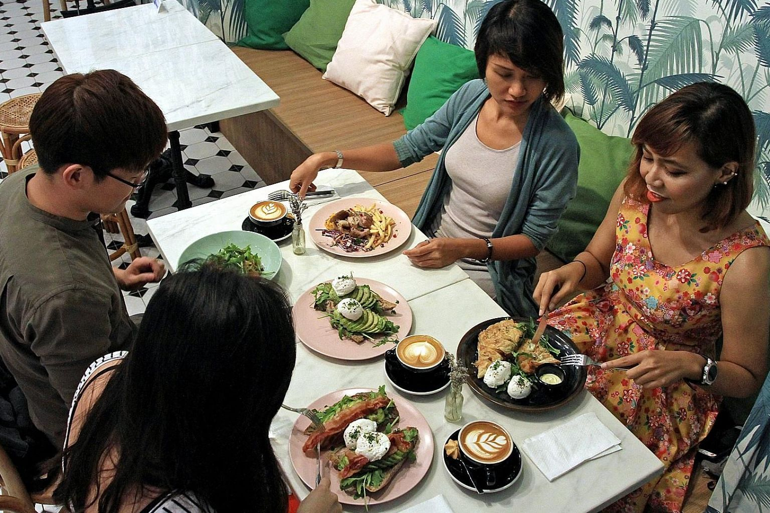 (Clockwise from bottom left) Supply operations executive Jacqueline Chua, 26, digital marketing executive Terry Pang, 26, musician Salima Nadira, 27, and business intelligence executive Marliyana Amir, 26, having a meal together at Shop Wonderland in