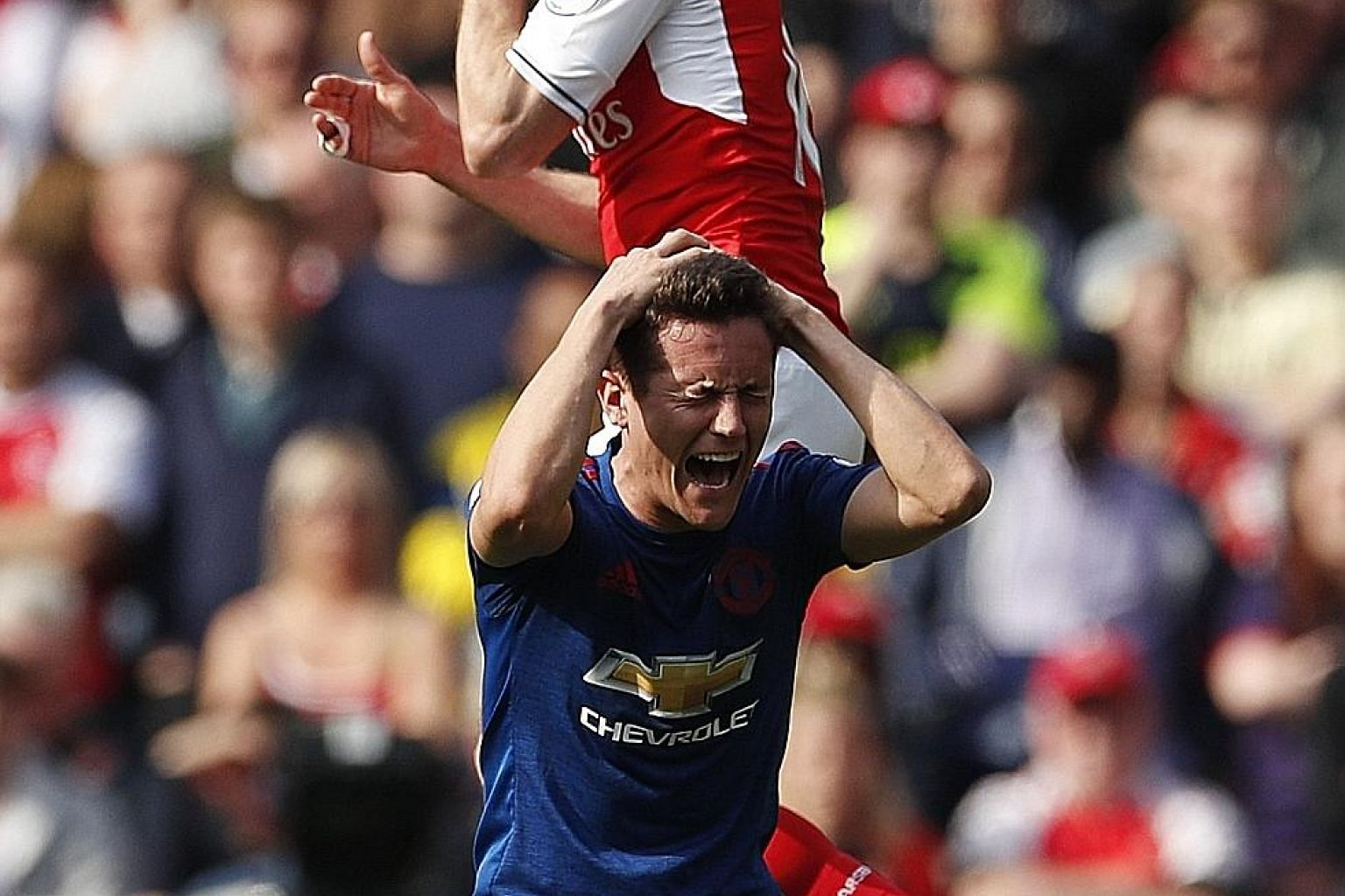Manchester United's Ander Herrera in pain after clashing heads with Arsenal's Nacho Monreal in their Premier League game earlier this month. Dr John Leddy says that each athlete should be checked and treated on an individual basis, with extra care ne