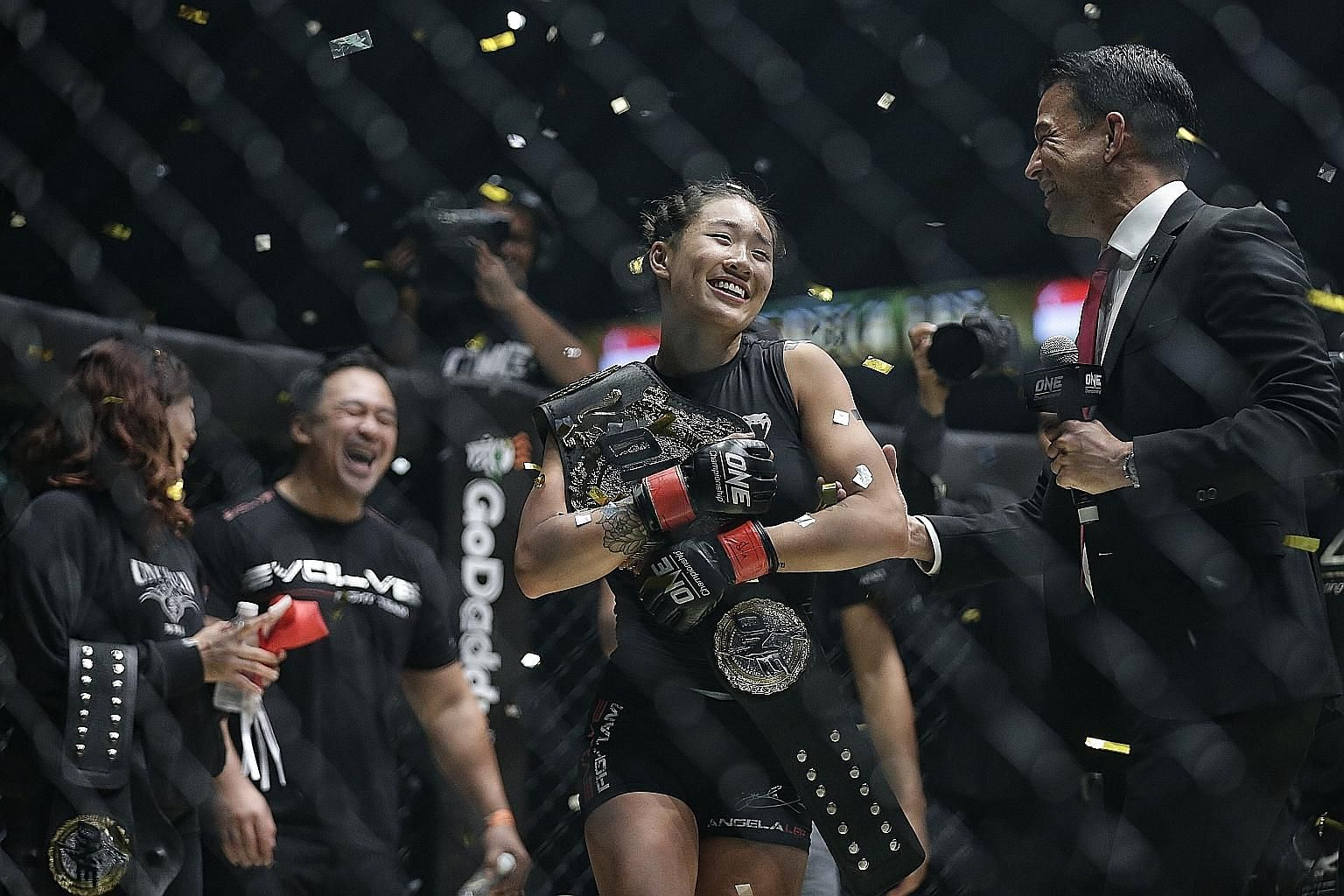 "One Championship women's atomweight world champion Angela Lee ""living the dream"" as she retained her title at the Dynasty of Heroes event at the Singapore Indoor Stadium on Friday night. The mixed martial arts star defeated Brazil's two-time muay tha"