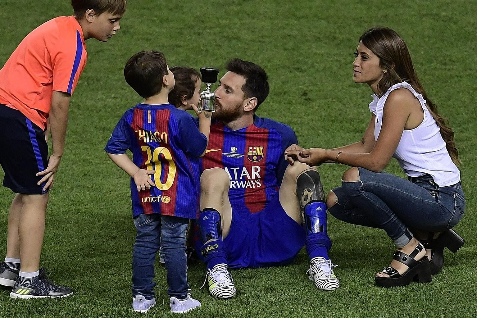 Lionel Messi soaking in the King's Cup final victory over Alaves with his sons and fiancee Antonella Roccuzzo. Barcelona won 3-1 in coach Luis Enrique's last game.
