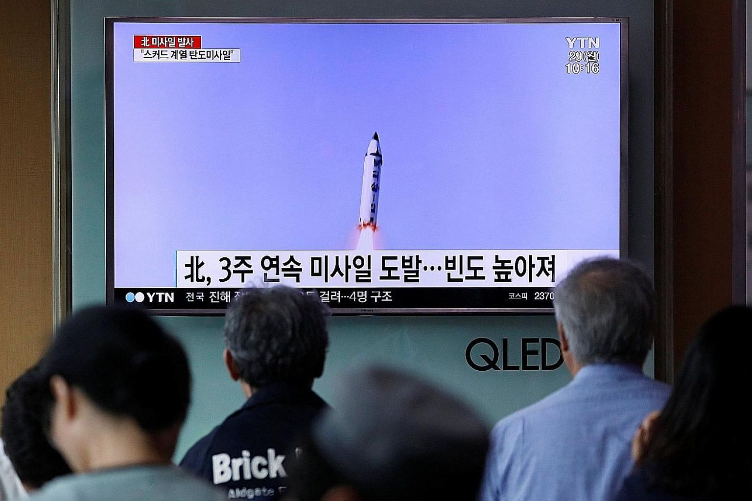 People watching a news report at a railway station in Seoul about North Korea firing what appeared to be a short-range ballistic missile yesterday.