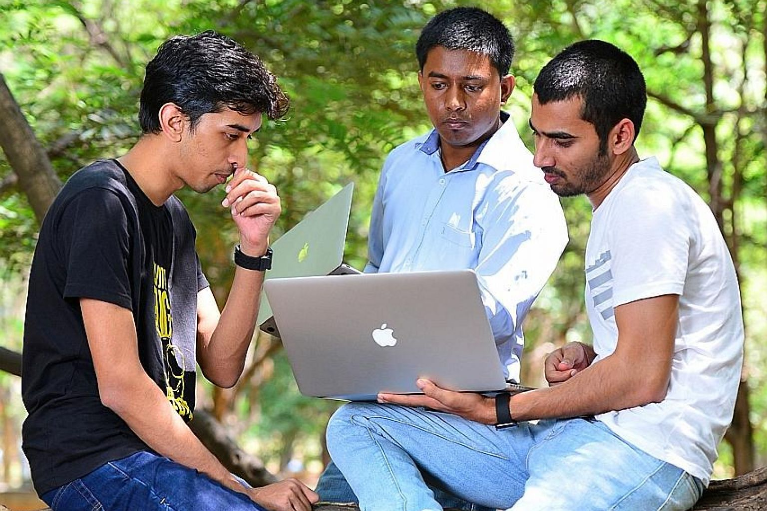 Mr Anand Prakash (right), who runs cyber security firm AppSecure India, meeting fellow ethical hackers at a public park in Bangalore recently. India's army of ethical hackers earn millions protecting foreign corporations and global tech giants from c
