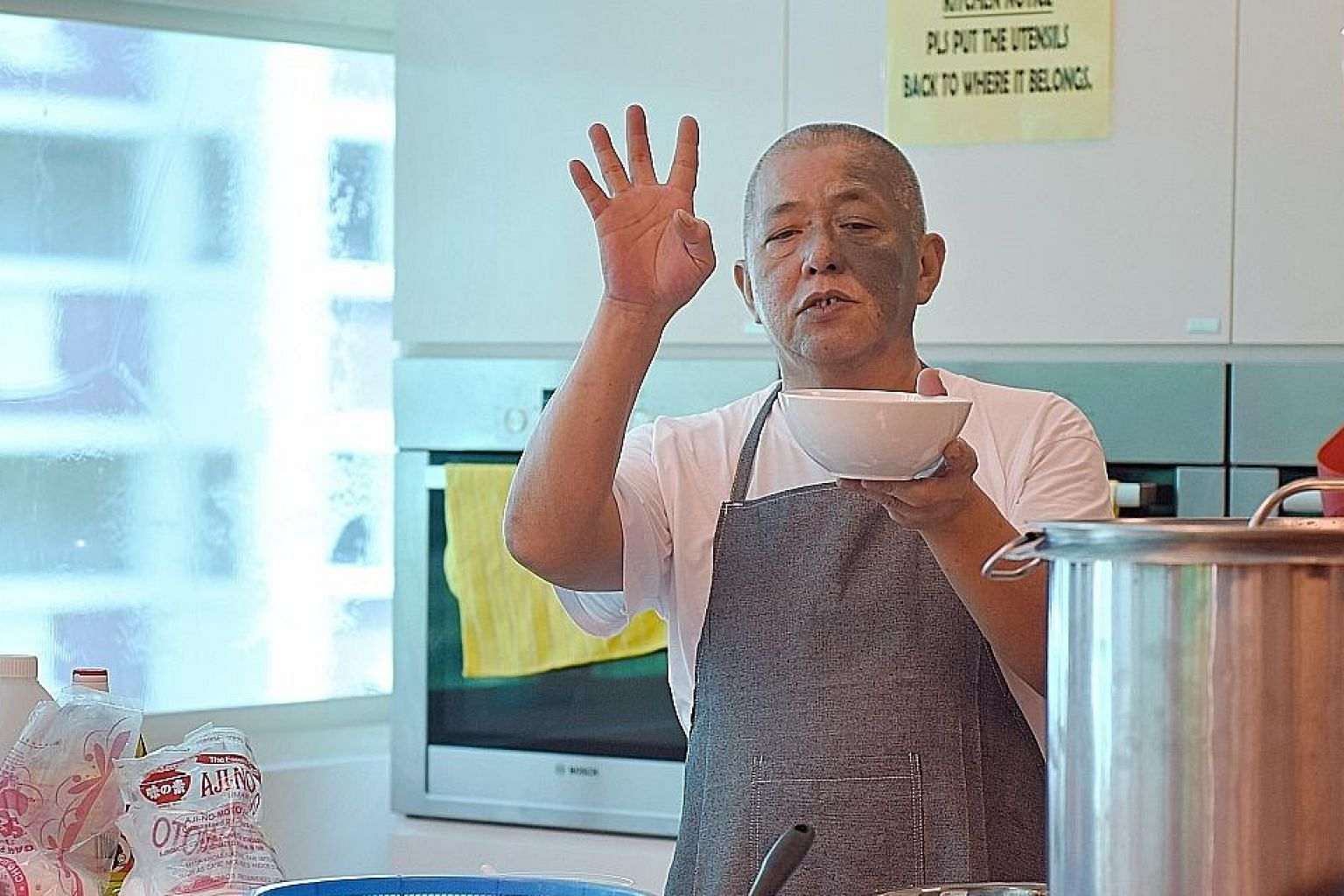 Veteran chicken rice hawker Neo Cheng Leong, 57, imparting his skills during a Hawker Fare Series cooking class yesterday.