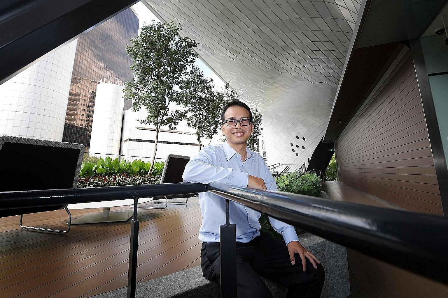 """Mr Aaron Foong at The Scotts Tower. The design of the condominium with an elevated floor plate frees up space on the lower storeys for an """"open view"""" and room for residents to move around, he says."""