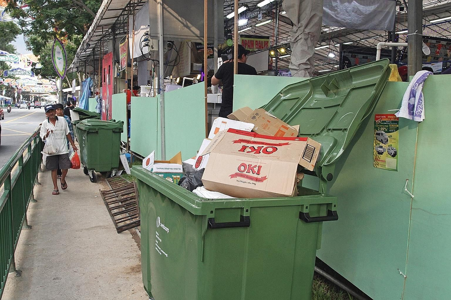 Rubbish bins at the back of food stalls along the street in Geylang Serai are sometimes left open. NEA made more than 148,500 inspections and took over 3,200 enforcement actions against food outlets last year, up from about 146,500 inspections and ab