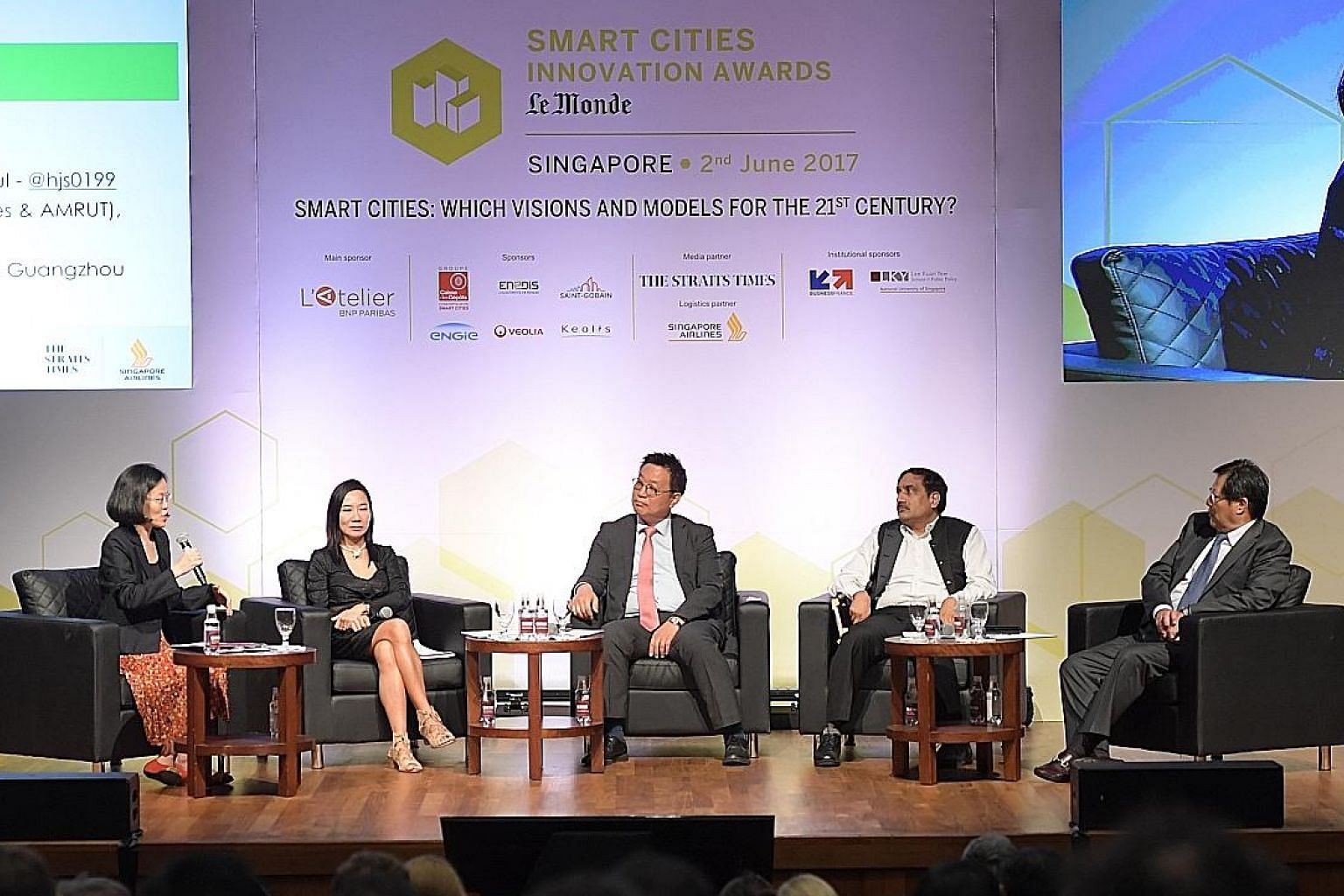 (From left) Panel moderator and ST associate opinion editor Lydia Lim with Singapore's Centre for Liveable Cities director for research Limin Hee, Seoul's National Information Society Agency senior researcher Jong Sung Hwang, India's Smart Cities Mis