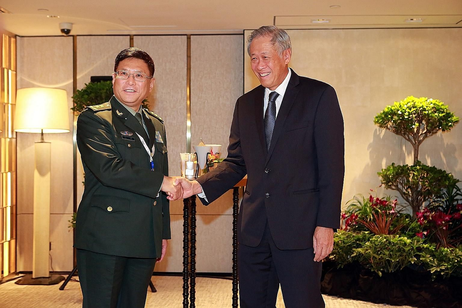 Defence Minister Ng Eng Hen greeting Lt-Gen He Lei, vice-president of the People's Liberation Army Academy of Military Sciences, at the Shangri-La Dialogue yesterday. Dr Ng and US Secretary of Defence James Mattis on their way to a breakfast meeting