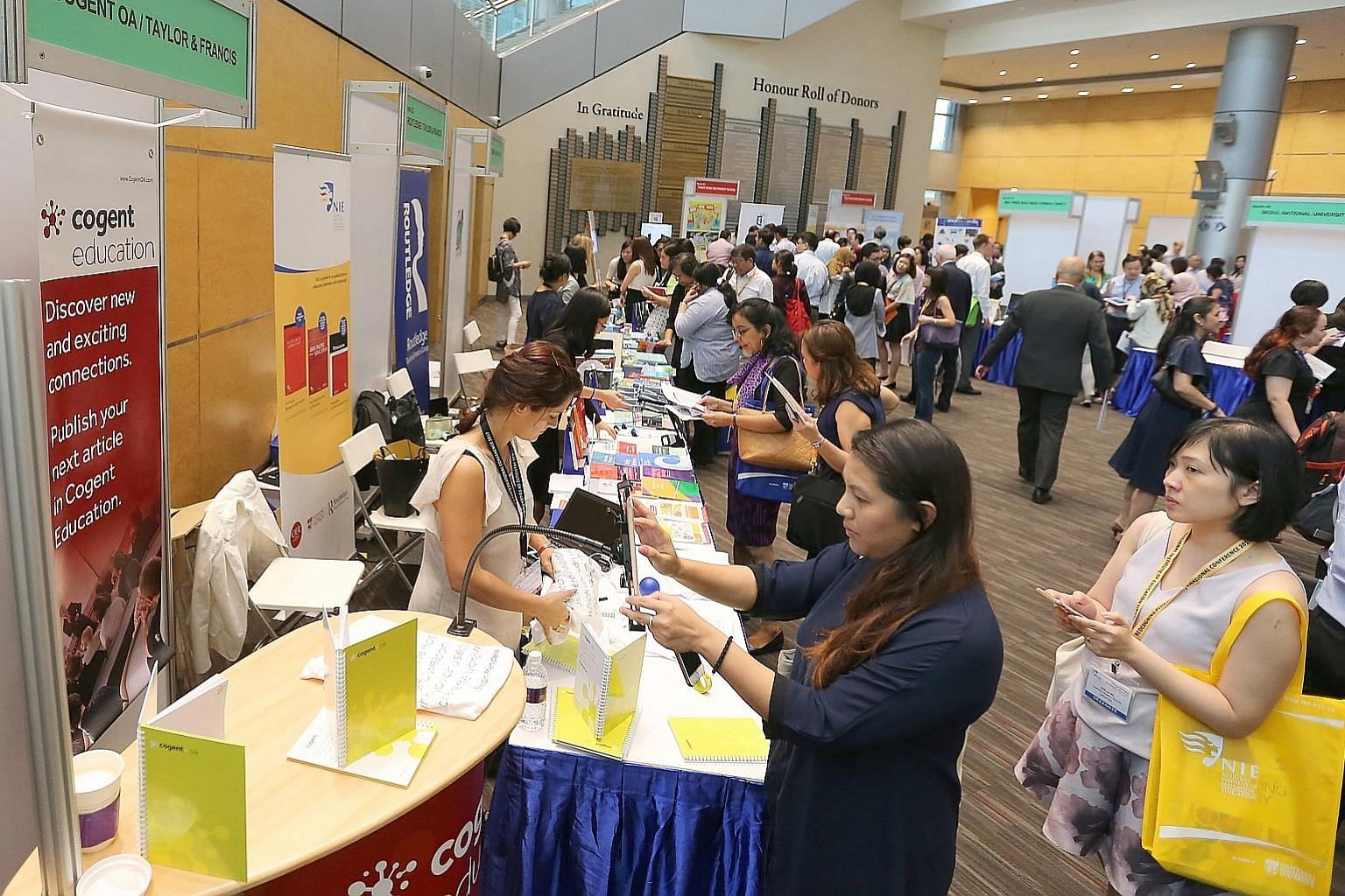 A showcase at last week's Redesigning Pedagogy International Conference. There were seven booths featuring publishers and education vendors and two school showcases put up by Yusof Ishak and Teck Whye secondary schools. (From left) Prof David Carr, P