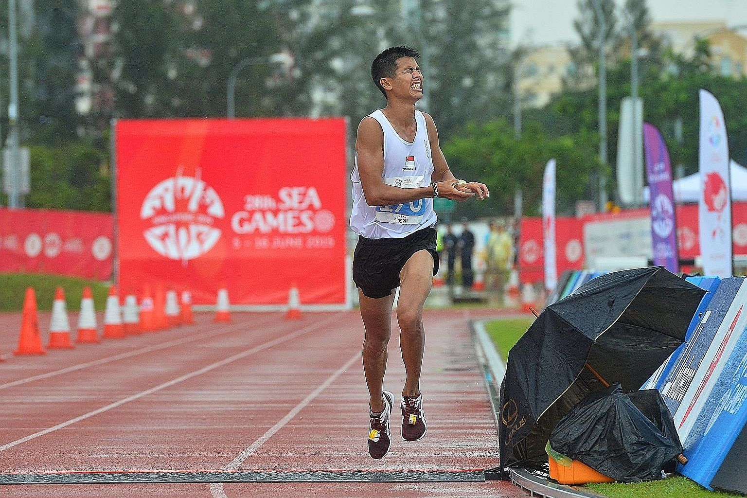 Singapore's Ashley Liew Wei Yen crosses the marathon line in eighth place at the 2015 SEA Games after his act of sportsmanship during the race.
