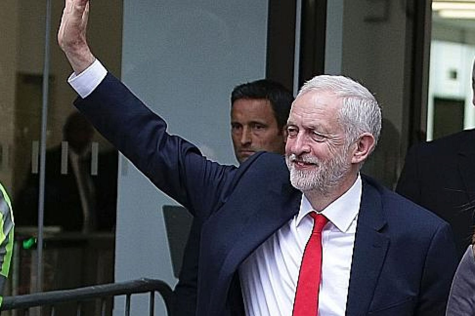 Labour leader Jeremy Corbyn, who began the campaign with historically low favourability numbers, acknowledging supporters as he left the party headquarters in central London yesterday after his stunning comeback.