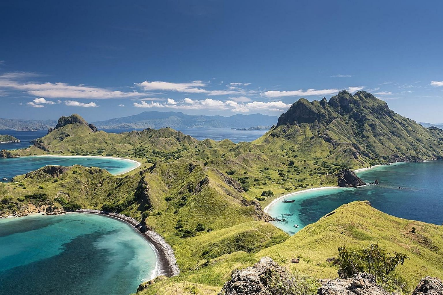 The top of the hill on Padar island offers views of Komodo National Park and its crescent beaches.