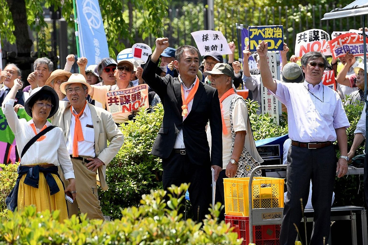 "Demonstrators protesting against the controversial ""anti-conspiracy Bill"" near the Parliament building in Tokyo yesterday, after the Upper House passed it. The law punishes 277 crimes and takes effect next month."