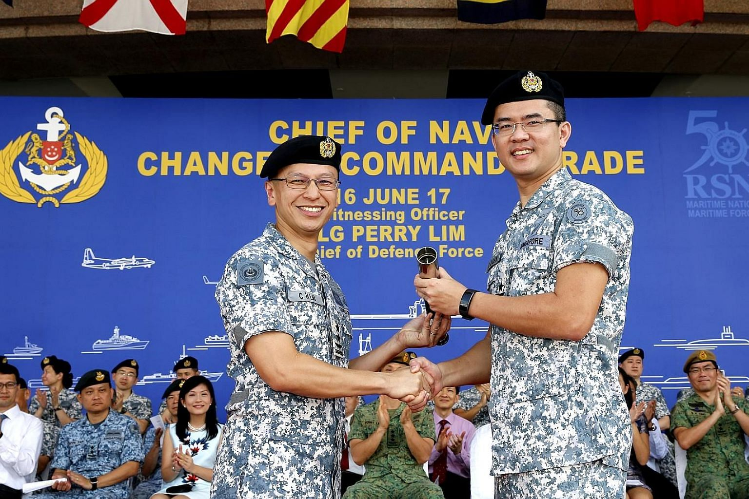 The command of the Republic of Singapore Navy (RSN) was handed over to Rear-Admiral (RADM) Lew Chuen Hong (right), by outgoing navy chief Lai Chung Han at RSS Singapura - Changi Naval Base yesterday morning. RADM Lew, 41, joined the Singapore Armed F