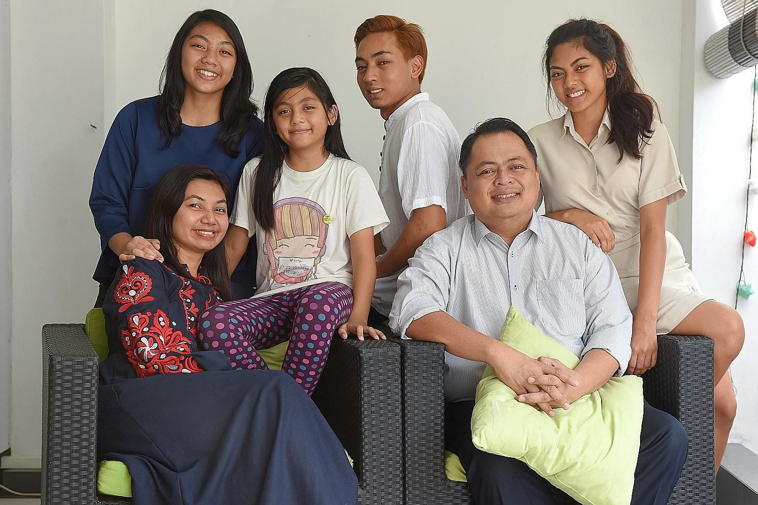 School teacher Norharyati Hassan and Nahar Azmi Abdul Majid with their children (from left) Sarah Nahar Azmi, 14; Zahra Nahar Azmi, eight; Faris Nahar Azmi, 19, and Nadhrah Nahar Azmi, 17. Mr Nahar bought their terrace house in Opera Estate in 2009 f