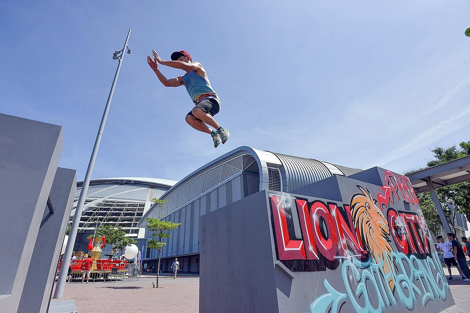 A parkour enthusiast clearing an obstacle at the Lion City Gathering. A competition featuring professional parkour artists will be held today.