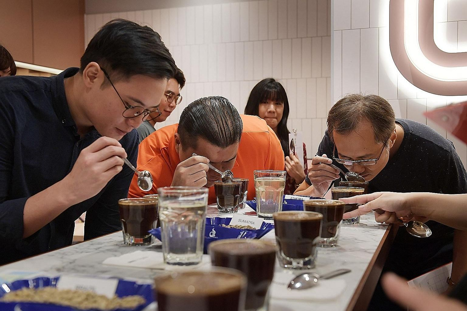 At Jewel Coffee, participants make tasting notes as they smell and sip different types of coffee. They also got to try cupping, a coffee-tasting technique, to evaluate the aroma and flavours of different beans.