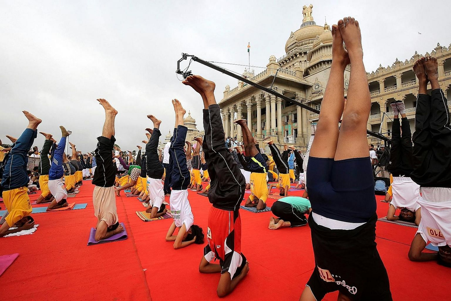 In an attempt to break a record in Bangalore, 2,000 yoga enthusiasts put mind and body to the task, performing the headstand pose for 30 seconds in front of the Vidhana Soudha - the seat of the state legislature of Karnataka, yesterday. The event was