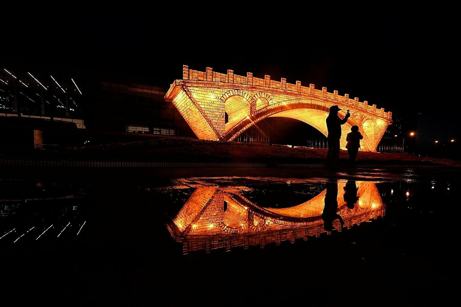 """A """"Golden Bridge on Silk Road"""" installation set up outside the National Convention Centre in Beijing for the Belt and Road Forum on International Cooperation held last month. During the summit, Chinese President Xi Jinping pledged an additional US$12"""