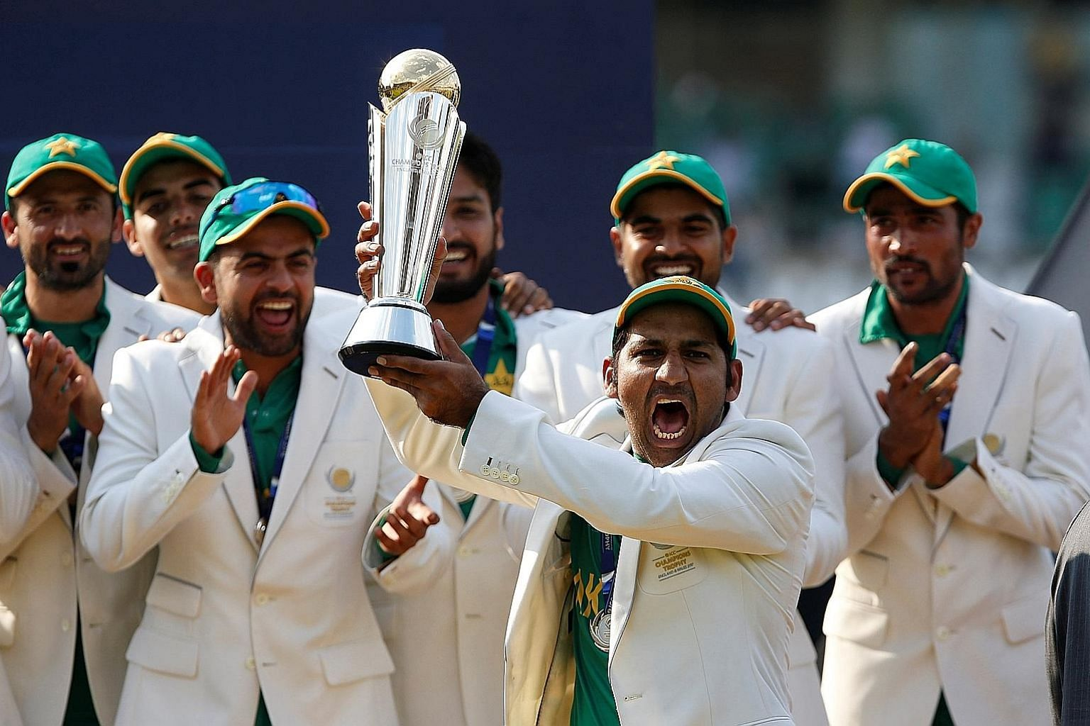 Pakistan players celebrating with the ICC Champions Trophy on Sunday after their comprehensive 180-run victory over India, who had trounced them in the first group game.