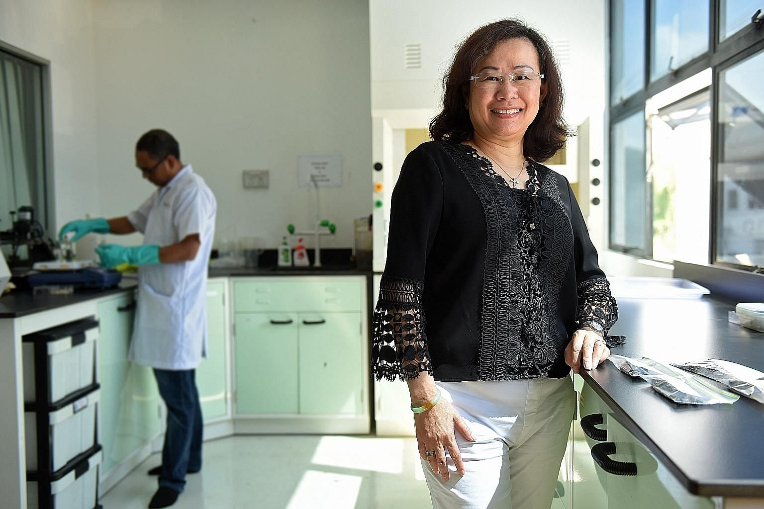Mrs Allister Rochstad in TuffChem's lab at Loyang Drive. The company tests new chemicals which are not yet produced in the market to improve cleaning processes.