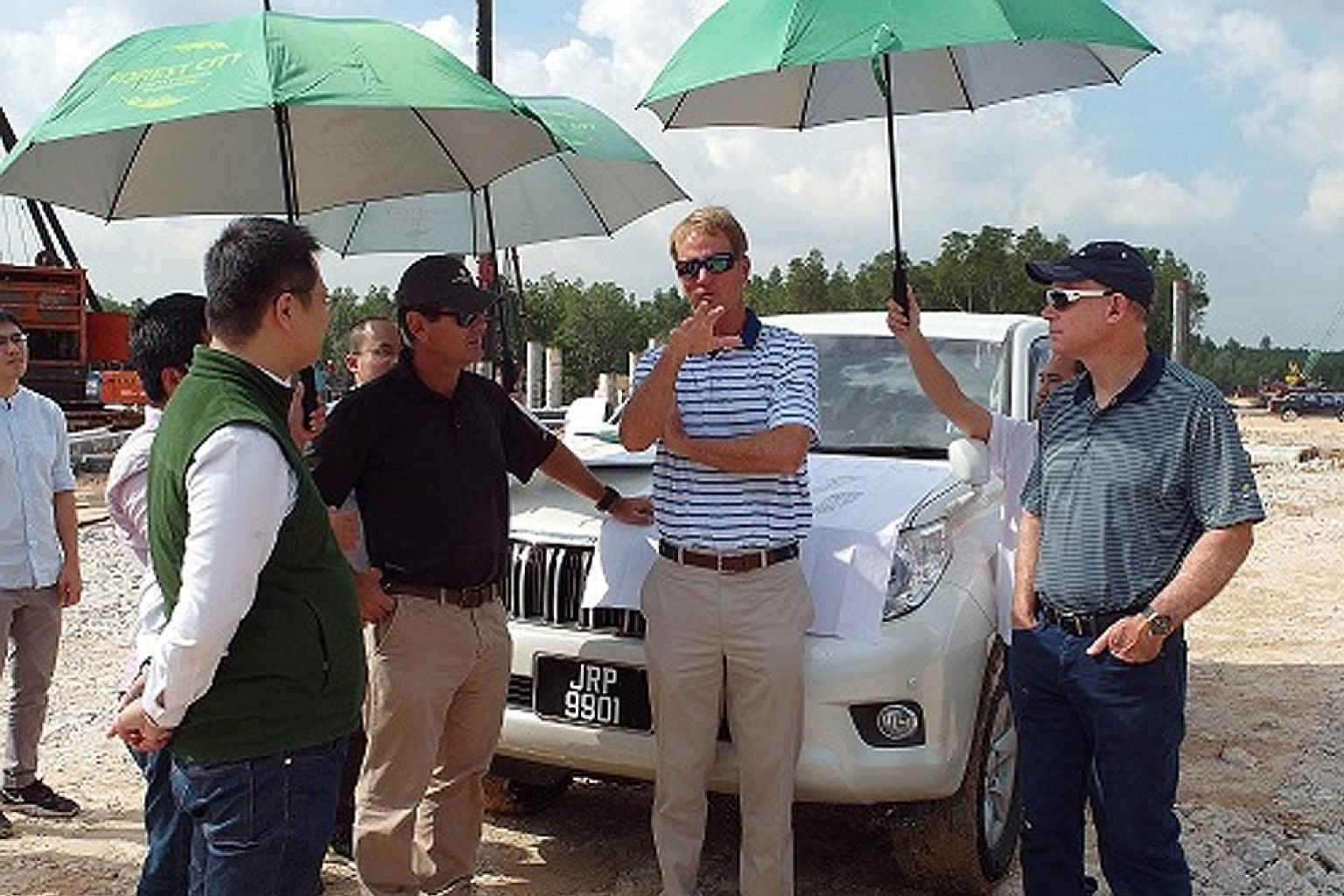 Mr Jack Nicklaus II (centre) surveying the area at Forest City.