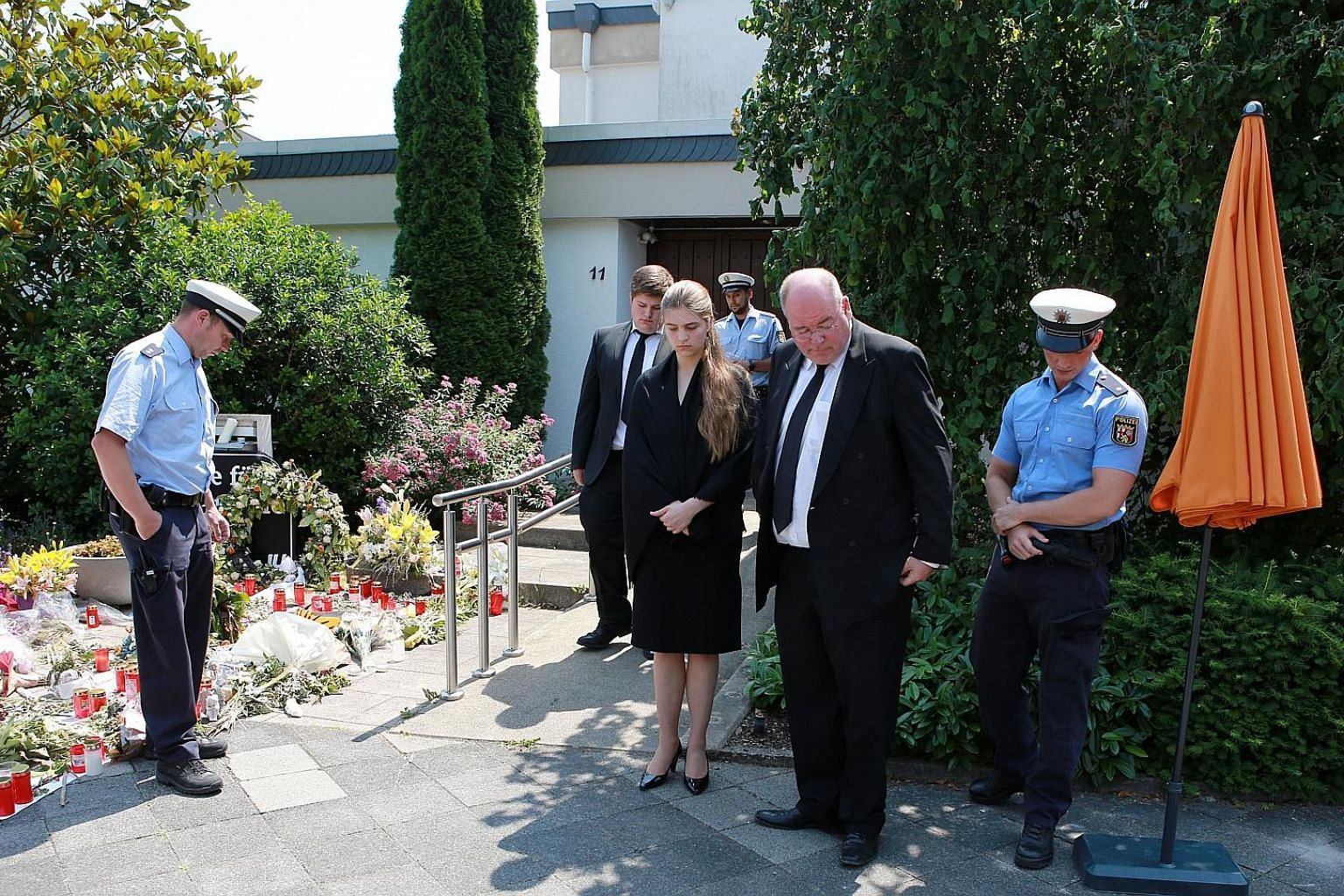 Above: Mr Helmut Kohl died on Friday at the age of 87. Left: Mr Walter Kohl, his son, and his niece were seen standing outside the late former German chancellor's home in Oggersheim, Ludwigshafen, on Wednesday after being turned away at the door in f