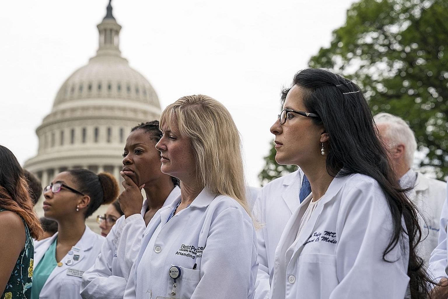 """Healthcare workers protesting outside the Capitol on Thursday. Democrats have called the new health plan a """"war on Medicaid""""."""