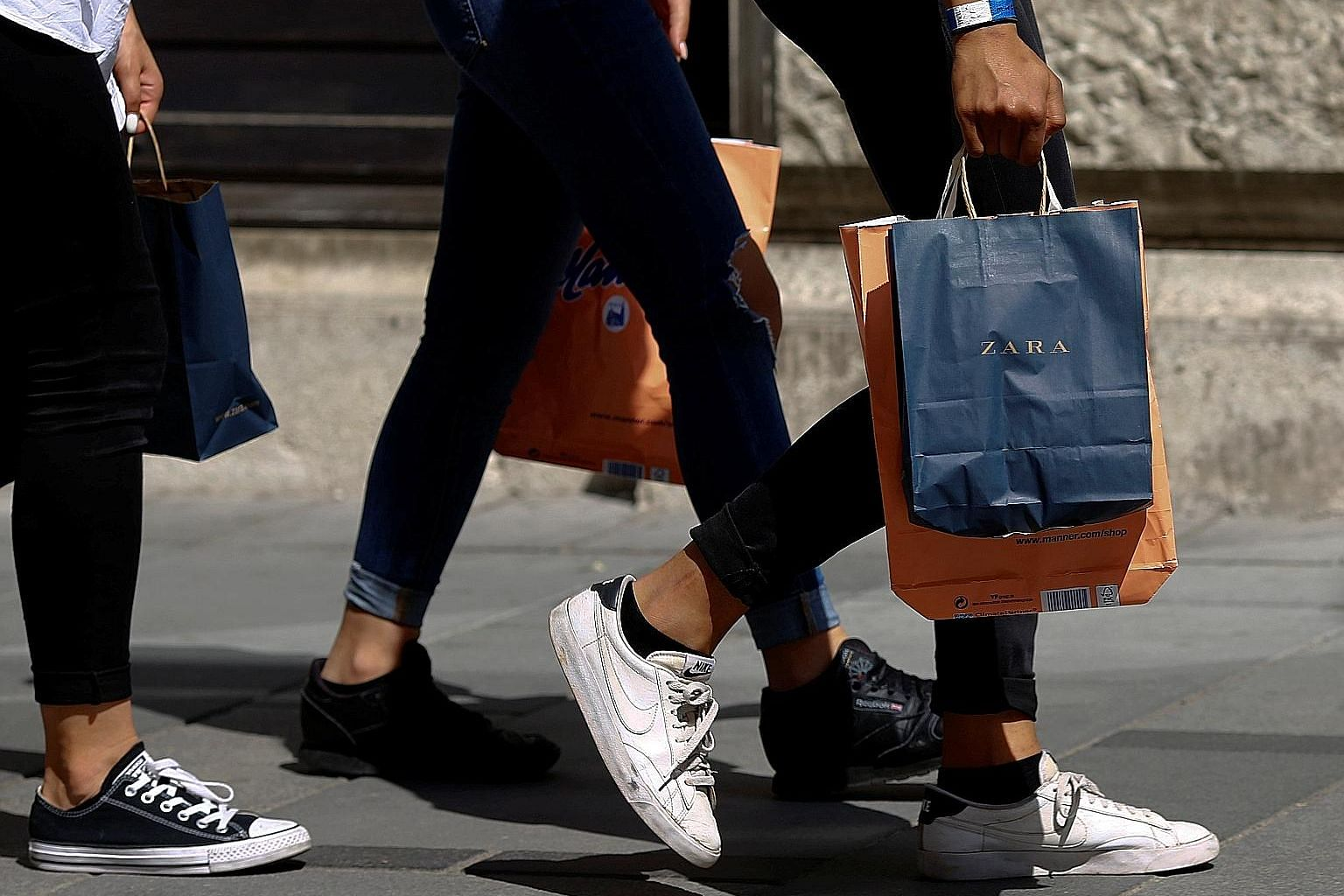 A shopper in Vienna carrying a bag from Spanish fashion retailer Zara. Prices of the brand's products seem to vary widely from country to country.