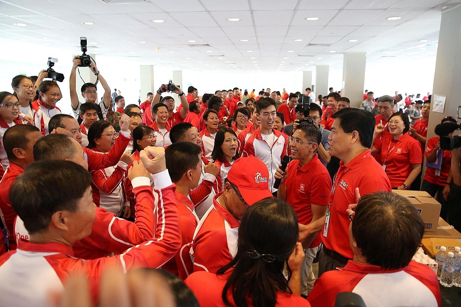 Senior Minister of State for Defence Maliki Osman speaking to some participants of the National Day Parade 2017 yesterday afternoon before the event's first combined rehearsal at the Marina Bay Floating Platform. He thanked them for their hard work o