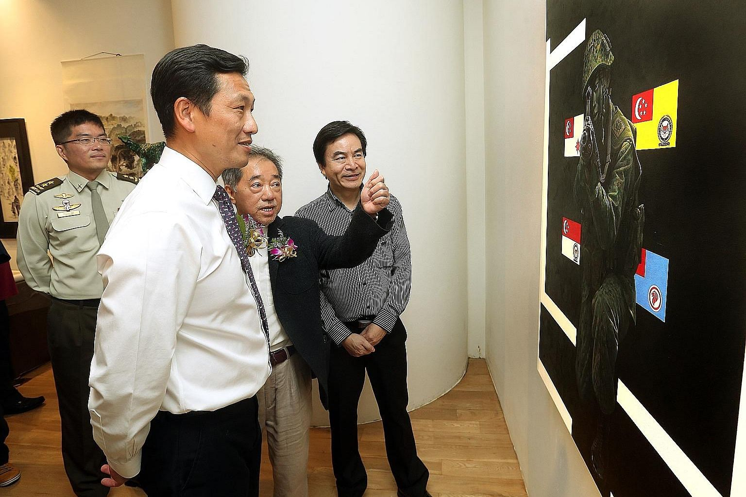 Above: (From left) Chief of Army Melvyn Ong, Second Minister for Defence Ong Ye Kung, Singapore Art Society president Terence Teo and artist Tan Rui Rong at the launch of the public exhibition at Ion Art Gallery yesterday. Right: Artist Kevin Tan wit