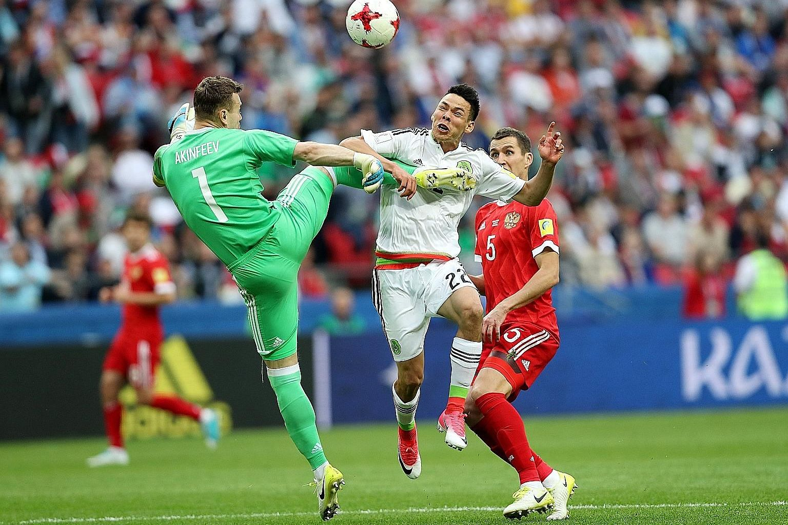 Mexico winger Hirving Lozano scoring the winner past goalkeeper Igor Akinfeev of Russia as the hosts exited the Confederations Cup.