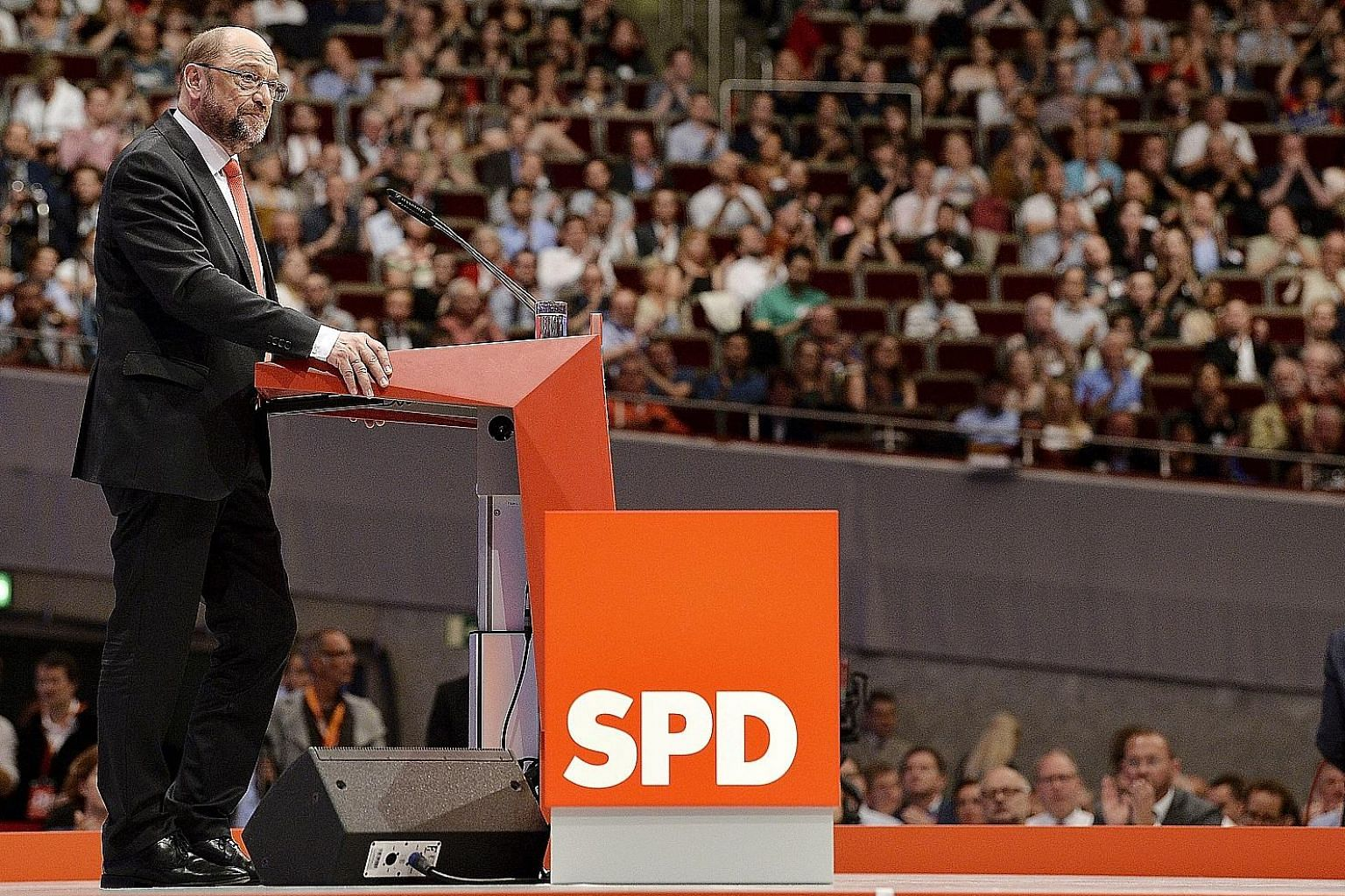 Mr Martin Schulz, Social Democratic Party (SPD) chairman and candidate for chancellor, at the party's conference in Dortmund, Germany, yesterday. Mr Schulz said his election manifesto will focus on free education, reducing the tax burden on low- and