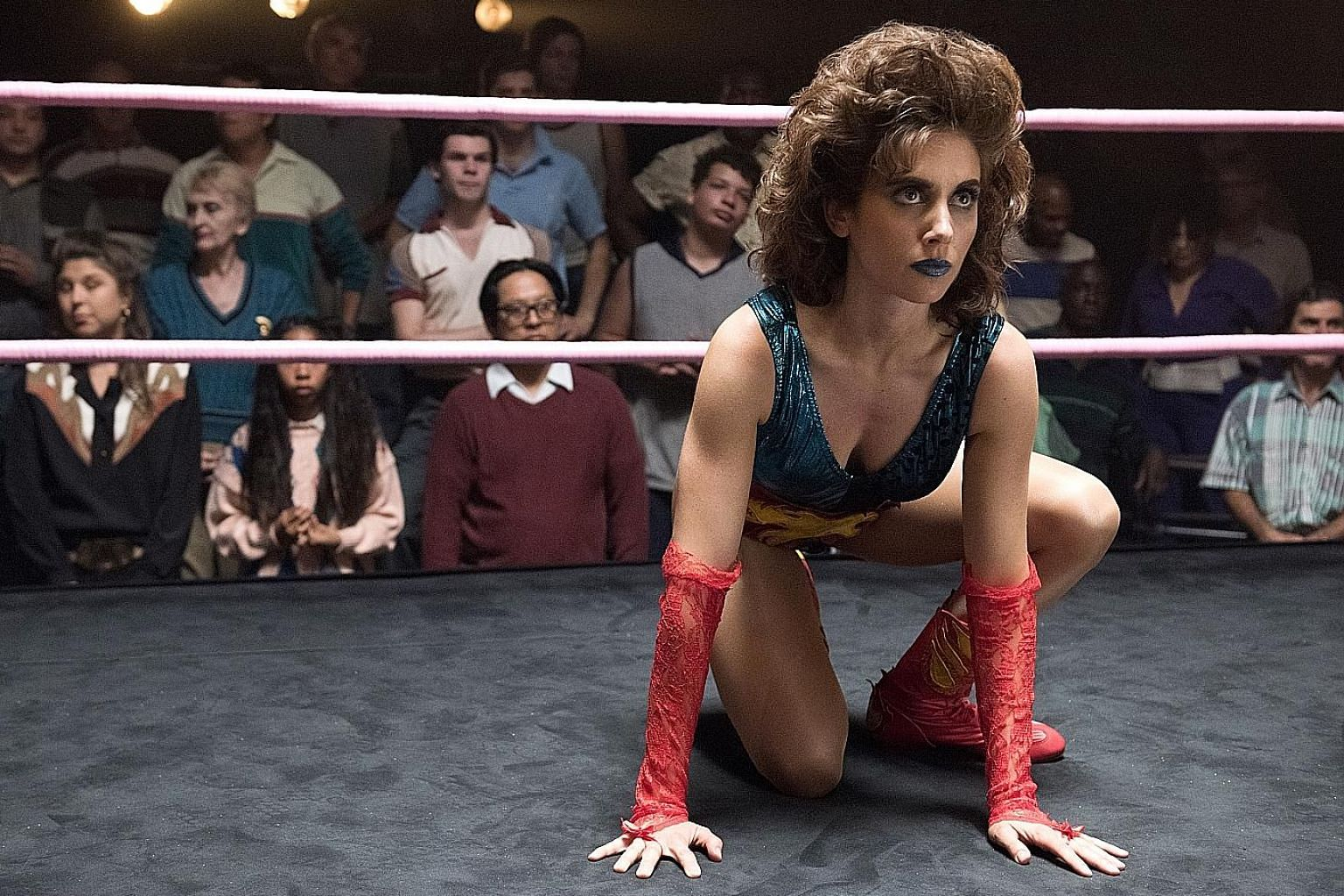 In Glow, actress Alison Brie perms her hair and plays wrestler Ruth Wilder.