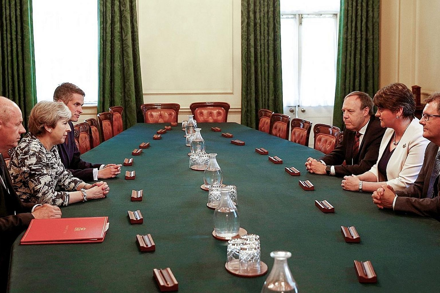 At the meeting yesterday held at 10, Downing Street in London were (clockwise from left) First Secretary of State Damian Green, Prime Minister Theresa May, Conservative Chief Whip Gavin Williamson, and the Democratic Unionist Party's deputy leader Ni