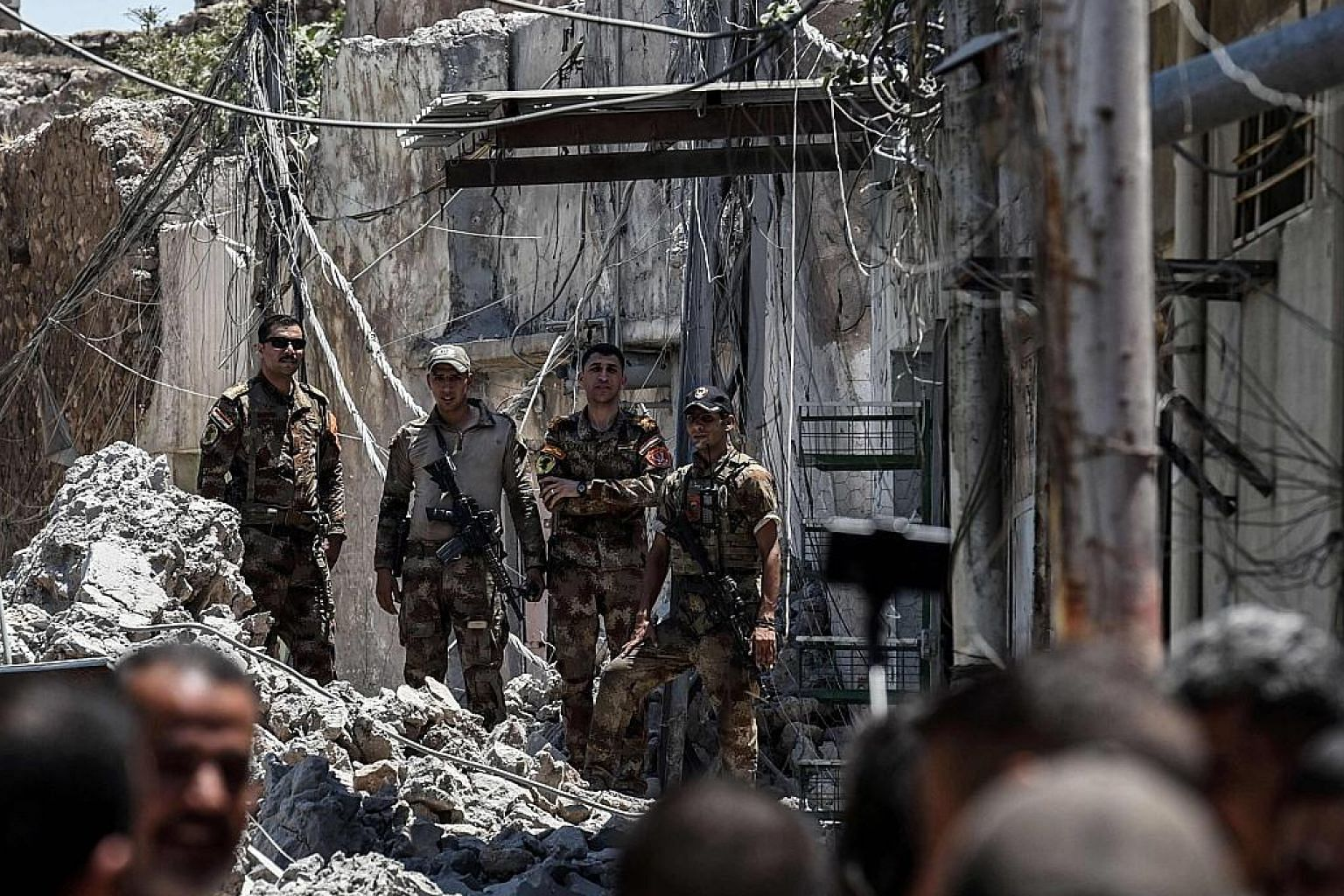 Iraqi forces advancing through Mosul's Old City on Sunday, as part of the ongoing offensive to retake the last district held by Islamic State in Iraq and Syria militants.