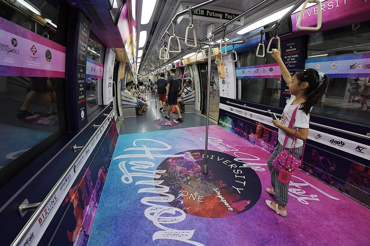 The Harmony Train, a collaboration between the Thye Hua Kwan Moral Society and the National Youth Council, has decals with messages promoting racial and religious harmony. It will run along the North-East Line throughout next month - which is both Ha