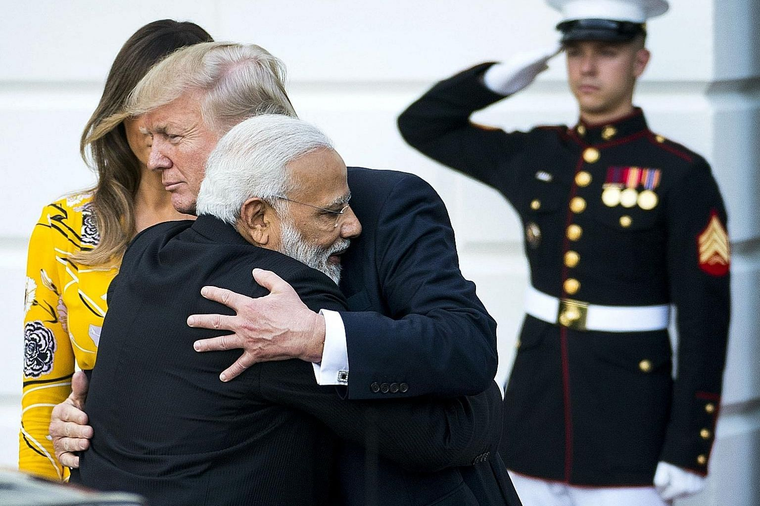 Indian Prime Minister Narendra Modi and US President Donald Trump exchanging a hug following their dinner at the White House on Monday. The Indian leader is known to hug leaders he gets on with.