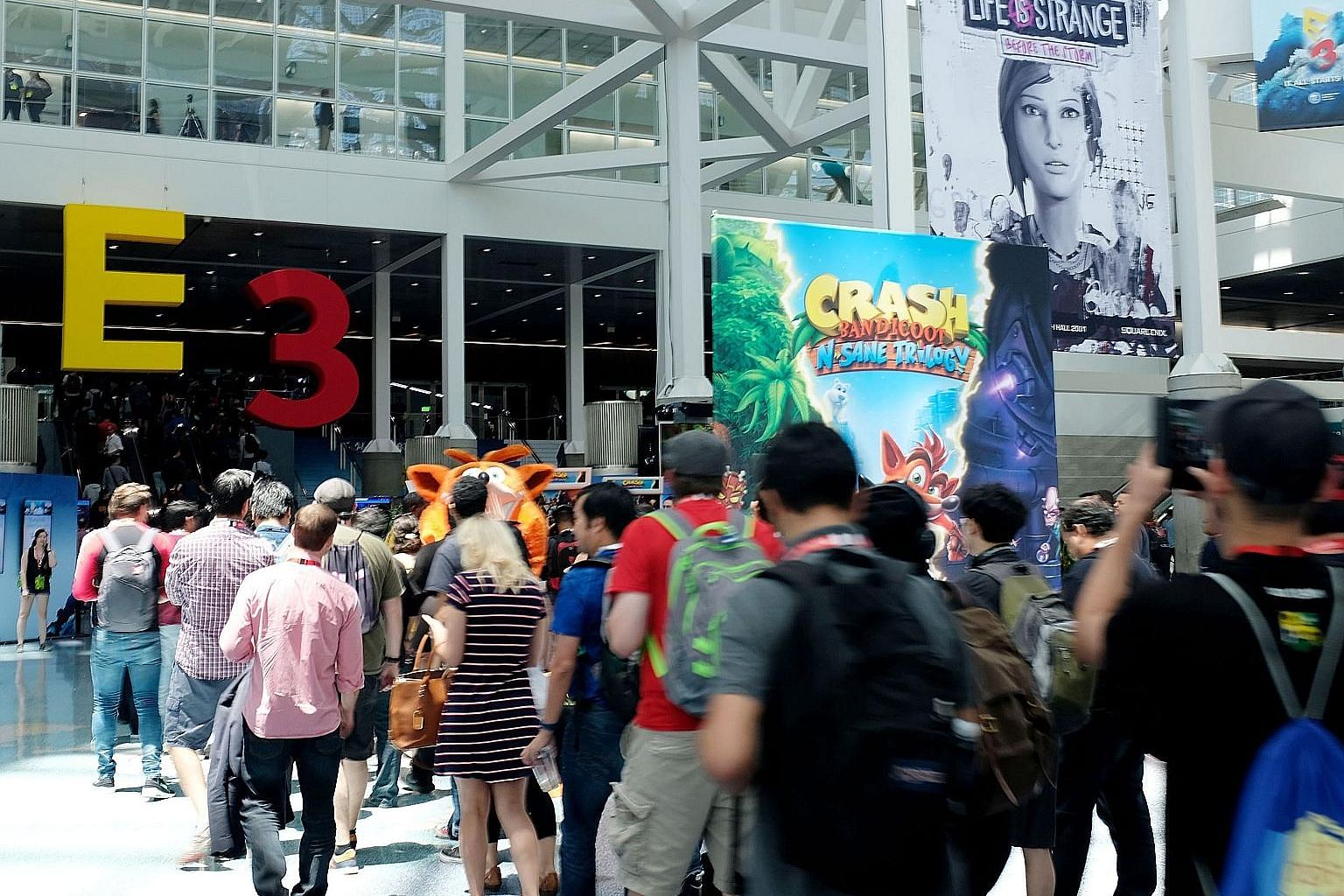 Visitors to the Electronic Entertainment Expo gaming convention queuing up to enter the exhibition hall at the Los Angeles Convention Center on June 15. It was the first time in its 22-year history that E3 had opened the show to the public.