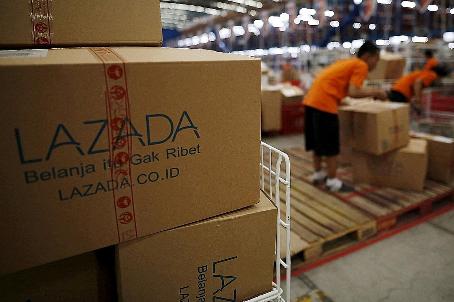 Lazada staff at a Jakarta warehouse. The firm covers six countries and runs about a dozen warehouses and several distribution centres.